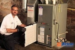 Airtron Tech Working On Furnace